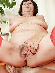 Overweight granny lesbians spread and finger hairy vaginas in stockings