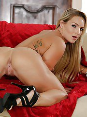 Blonde MILF Cali Carter showing off tattoos and sexy legs after stripping