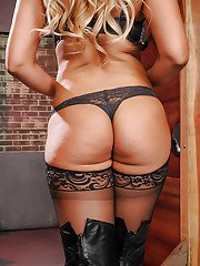 Latina solo girl Bridgette B posing non nude in lingerie hosiery and boots