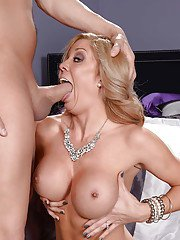 Blonde mom Parker Swayze has big boobs freed from dress before big cock bj