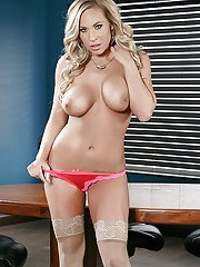 Busty blond solo girl Olivia Austin unleashing big all natural tits at work