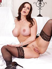 Brunette MILF babe Kendra Lust teasing in stockings and lingerie