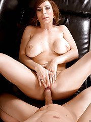 Gonzo style action with busty redhead mom Savannah Jane giving blowjob