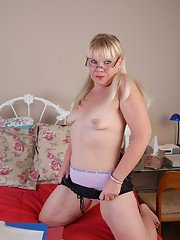 Aged glasses attired chubby lady Haley spreading shaved pussy
