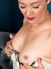 Mature Euro dame Kitty Cream stripping down to lingerie and stockings