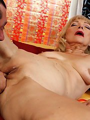 Hardcore cumshot on mature saggy tits after shaved pussy licking