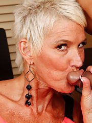 Short haired cougar Lexy Cougar taking cumshot in mouth after bj on knees