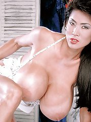 Solo Asian babe Minka showing off monster boobs and hairy pussy