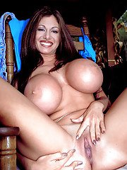 MILF solo girl Crystal Gunns unveils huge hooters and hairy snatch outside