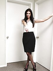 Brunette MILF stripping off skirt and nylons to bare small tits in office