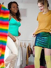 Black and white dykes Katherine J and Sara D pull on stockings after sex