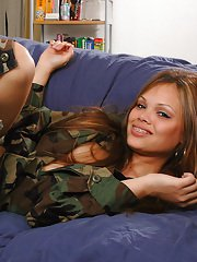 Amateur Latina babe in camouflage outfit and hat revealing clitoris