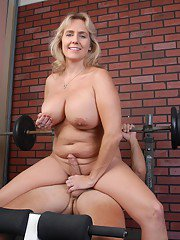 Older blonde fatty Wanda freeing big juggs in weight room before giving bj