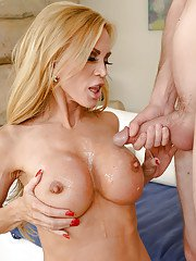 Blonde MILF cougar Amber Lynn removing lingerie for cumshot on large tits