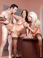 Busty MILFs Ava Addams and Riley Jenner blow cock in office threesome