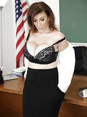 Stocking clad MILF teacher Sara Jay freeing huge juggs from lingerie