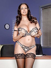 Stocking attired Euro brunette Ava Addams exposing large boobs in office