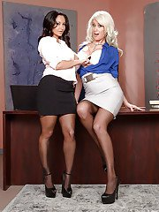 MILF lesbians Ava Addams and Riley Jenner expose huge hooters in office