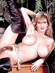 Busty mature blonde babe Busty Dusty sliding panties aside to spread beaver