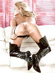 Latex attired babe Tawny Peaks freeing massive MILF pornstar tits in boots
