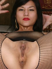 Amateur Asian solo girl sporting mesh see thru bodystocking in office
