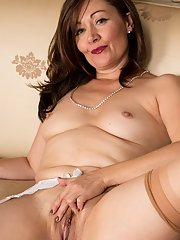 Chubby older broad Kitty Cream spreading labia lips after panty removal