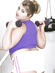 BBW solo girl Dayton Hines shows off huge tits and fat ass in weight room