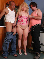 Mature blonde with fat ass enjoying interracial sex in MMF threesome