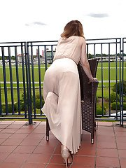 Older lady in dress and heels revealing beaver after outdoor panty shedding