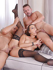 Stocking adorned Euro brunette Mea Melone taking hardcore DP in groupsex