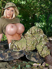 Chesty blonde Delzangel flaunts massive hooters in the forest