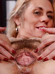 Leggy older blonde Cristine Ruby exposing nice mature ass and hairy cooter