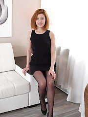 Flat chested redhead secretary toys puffy pussy in solo girl photo shoot