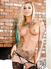 Tattooed blonde babe Kleio Valentien revealing big tits in stockings