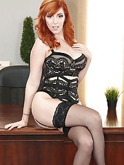 Stocking adorned redhead office babe Lauren Phillips exposing large tits