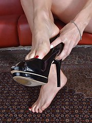 Busty mature woman Miss MelRose spreading long legs to reveal trimmed pussy