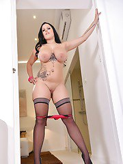 Dark haired chubby Themis Thunder revealing large hooters and tattoos