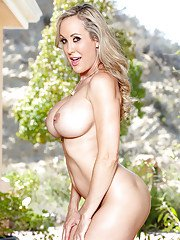 MILF pornstar Brandi Love unveiling large breasts and bare ass outdoors