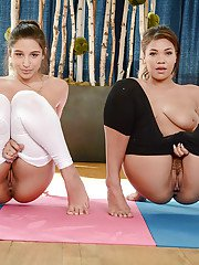 Busty lesbians Abella Danger and Cassidy Banks slip off yoga pants