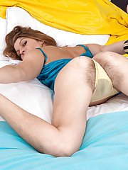 Mature hirsute lady spreading ugly pussy after panty removal