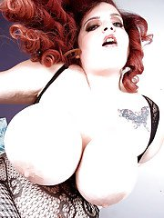 Redhead SSBBW Sashaa Juggs unleashing massive saggy tits from lingerie