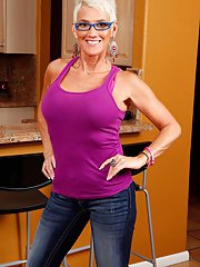 Glasses clad older blonde lady Lexy Cougar baring large tits in denim jeans