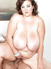 Obese mom Charlie Cooper freeing large juggs for nipple licking