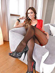European babe Natalia Forrest letting legs and feet free from pantyhose