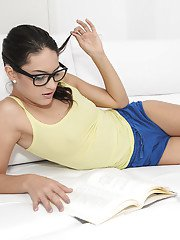 Glasses topped amateur solo girl Carolina Abril toying pussy in socks