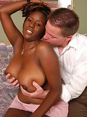 Mature ebony plumper Diva taking cumshot on large all natural black boobs