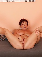 Aged BBW Jesica Hot revealing large tits before spreading for masturbation