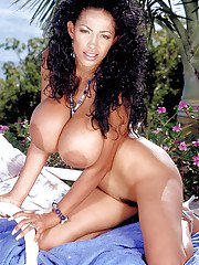 Mature Latina Busty Angelique exposing monster tits outdoors on beach