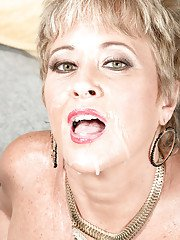 Short haired mature stocking clad woman Tracy Licks giving interracial bj
