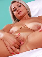 MILF Lina Peters undresses to reveal shaved pussy and meaty labia lips